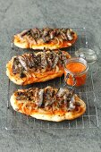 Flamenkuchen with caramelized onion and smoked sprats