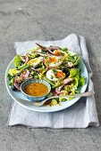 Salad with smoked sprats, green bean, black olives and eggs