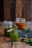 Three different varieties of pesto in glasses