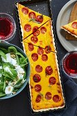 Pumpkin and tomato tart with a spinach salad