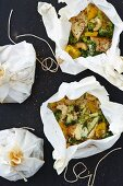Tofu with coconut, lime and couscous in parchment paper