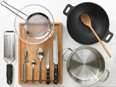 Cooking utensils for making a chicken wok dish with vegetables