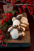 Anise biscuits and bunches of holly berries