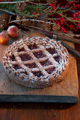 Linzer Torte (nut and jam layer cake) and bunches of holly berries