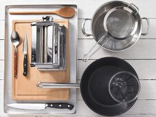 Kitchen utensils for the preparation of pasta with smoked fish
