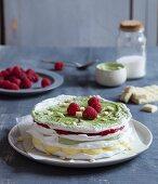 Matcha pavlova with raspberries and white chocolate