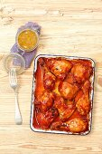 Chicken wings, thighs and drumsticks with barbecue sauce and apricot glaze