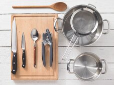 Kitchen utensils for the preparation of pasta with tomato sauce and smoked tofu