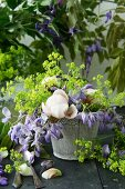 A bouquet of wisteria, peonies and lady's mantle