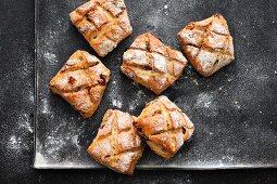 Muesli bread rolls on a baking tray