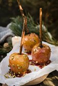 Caramel apples with chopped pistachios