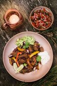 Chilli con carne with beef brisket, sour cream, guacamole and salsa