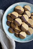 Shortbread Cookies dipped in Chocolate and Turmeric Sugar served with milk