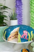 Coconut cream cake with a squid decoration for a maritime themed party