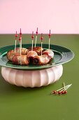 Dates wrapped in bacon with party skewers