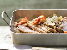 Oven cooked veal with beans and tomatoes