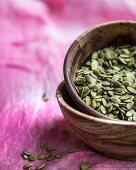 Wooden bowl of pumpkin seeds