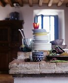 Plates stacked on rustic kitchen counter