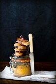 Duck liver in a glass jar with toasted bread slices