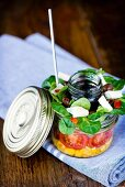 Lunch in a glass jar: corn salad, cherry tomatoes, lamb lettuce, goat's cheese and a balsamic dressing