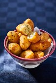 Cod beignets in a bowl