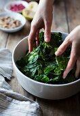 Mixing a kale salad