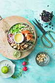 A salmon bowl with quinoa, pointed cabbage and wasabi mayonnaise