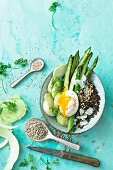 An asparagus bowl with poached egg, kohlrabi and mixed seeds
