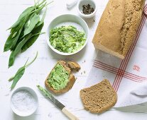 Homemade spelt and sesame seed bread with wild garlic butter