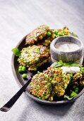 Pea and spinach fritters with ricotta and a herb yoghurt dip