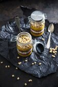 Mango and apple smoothie, chocolate coconut muesli, soy yogurt and oat pops in glass jars