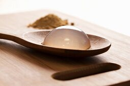 Raindrop cake on a wooden spoon (close up)