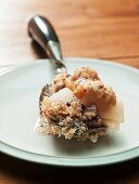 Pear crumble on a spoon (close up)