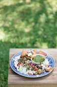 Garlic and lemon labneh with salsa verde and roasted pita bread corners