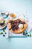 Almond butter and ricotta crostata with blueberries and thyme honey