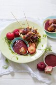 Parma ham-wrapped chicken, sage and plum kebabs with port and plum dipping sauce