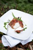 Bacon-wrapped goat's cheese with wild garlic