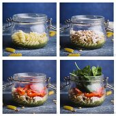 Salad with fusilli, pesto, red pepper, spinach, chicken and parmesan being made