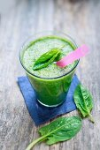 Green spinach smoothie with banana and mango