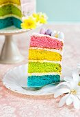 A slice of rainbow cake for Easter