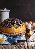 Blueberry and lemon cake baked in a rose bundt pan and topped with a powdered sugar glaze