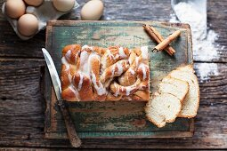 White yeast bread with cinnamon-sugar filling and powdered sugar icing