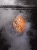 Ham in a smoking chamber