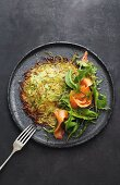 Asparagus and potato rosti with smoked salmon, lime and honey dressing and rocket