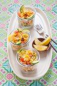 Vegan couscous and lentil salad in glasses