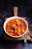 Sauerkraut soup with potatoes and pork sausages