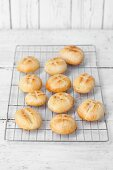 Freshly baked yeast rolls on a cooling rack