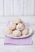 Quark balls coated in coconut on a plate