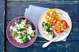 Stuffed peppers and broccoli with feta and red onions