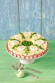 Egg salad with peas and mayonnaise, decorated like a pie